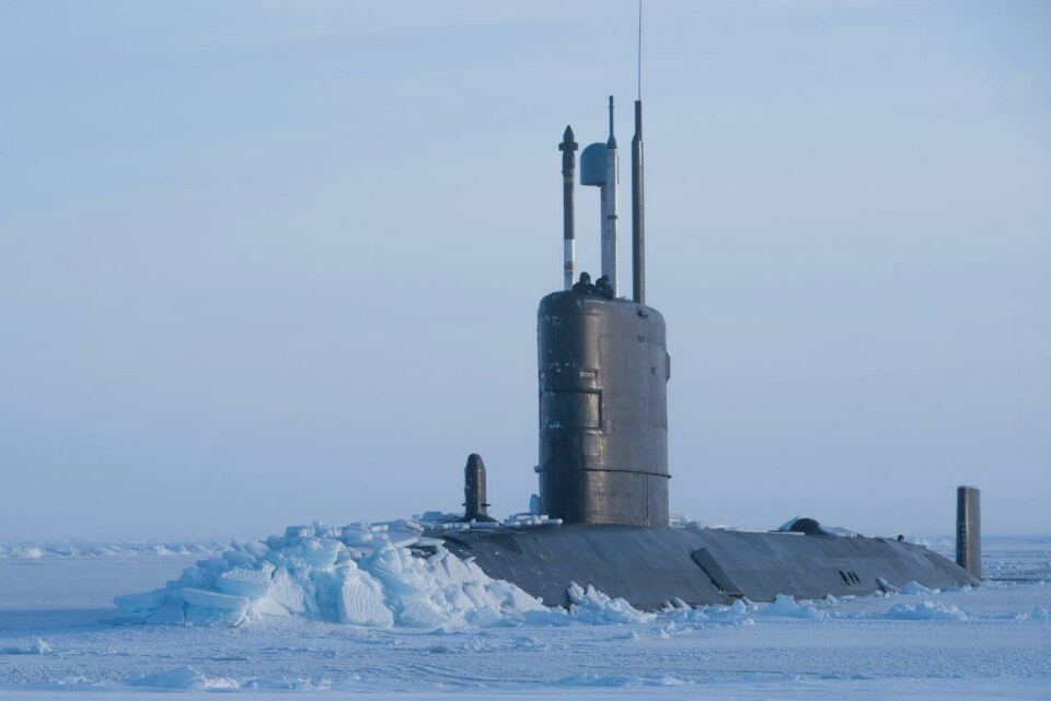 Submarine Breaks Through Arctic Ice For Major Exercise